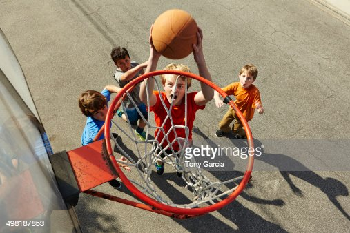 Boys playing basketball, high angle