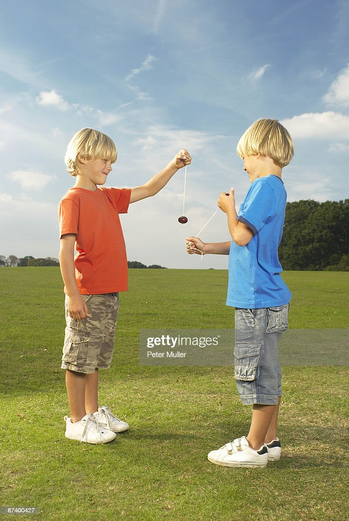 boys playing conkers : Stock Photo