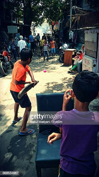Boys Playing Cricket On Street