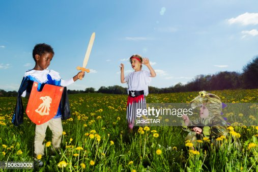 Boys playing dress up outdoors : Stock Photo