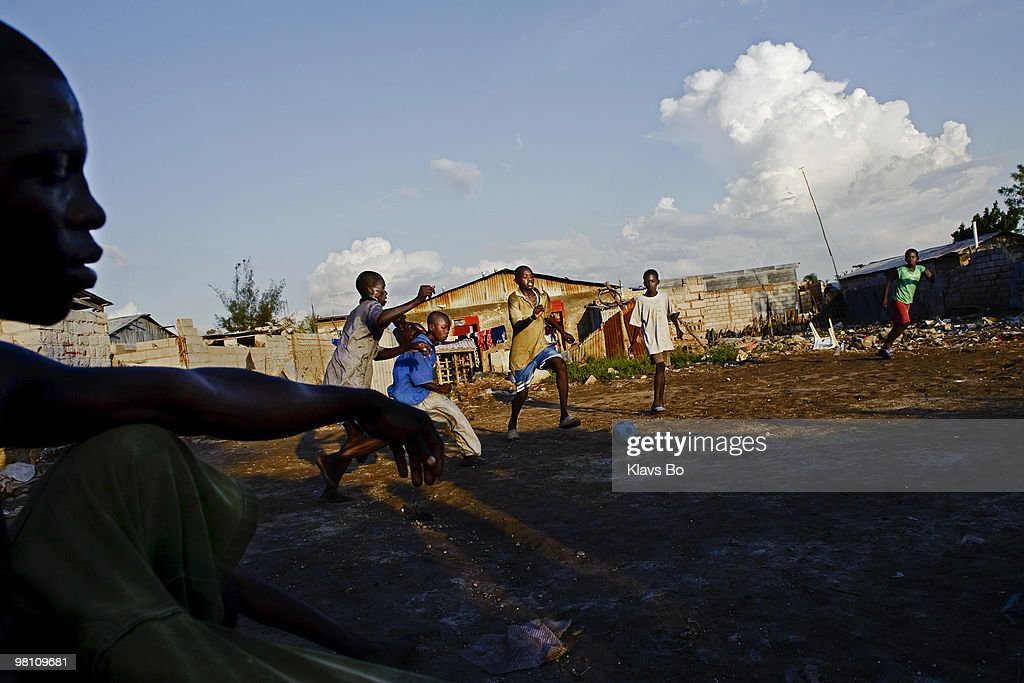 Boys playing football. During the first eight months of 2008 Haiti got hit by two tropical storms and two hurricanes leaving more than a million people homeless.