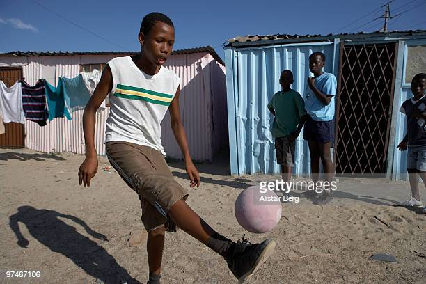 Boys playing football in South Africa