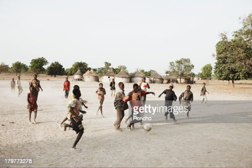 boys playing football in their village