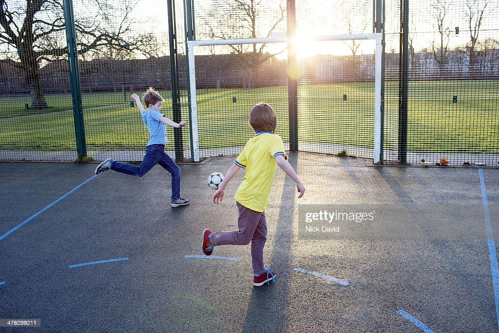 Boys playing football : Stock Photo