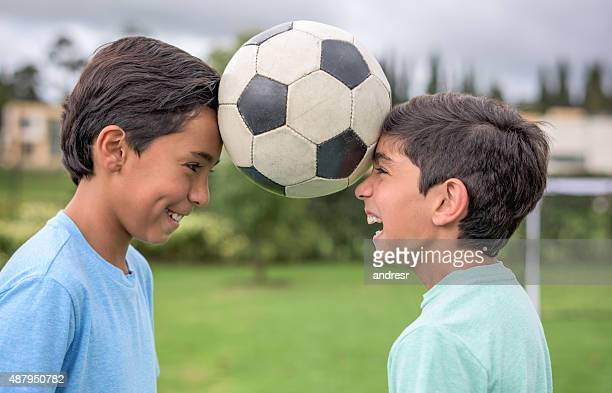 Boys playing football together