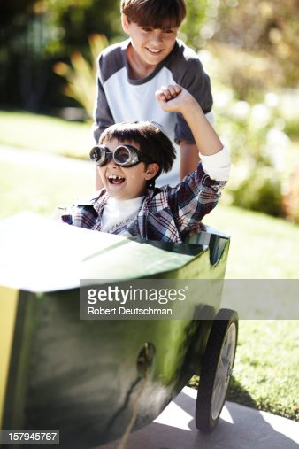 Boys playing in a go-kart. : Stock Photo
