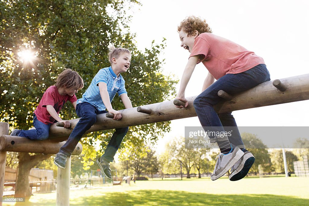 Boys playing in the park : Stock Photo