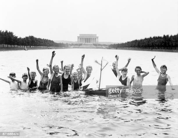 Boys playing in the reflecting pool in front of the Lincoln Memorial Washington DC USA 1926
