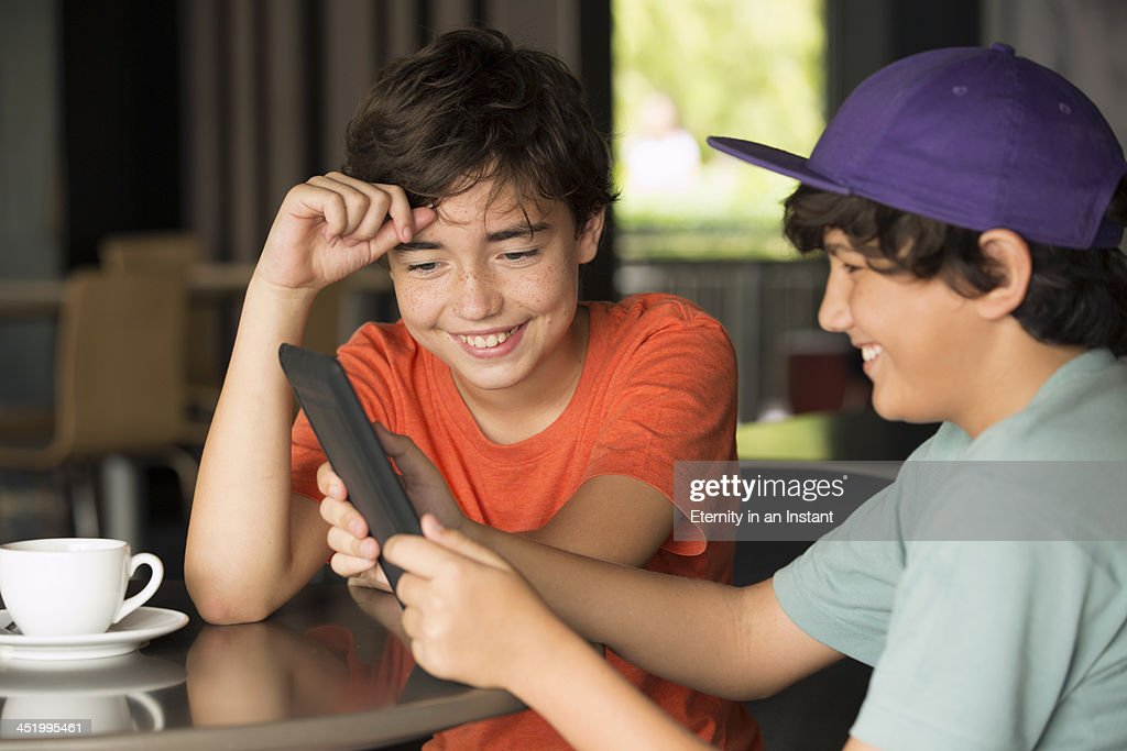 Boys playing on a digital tablet/ : Stock Photo