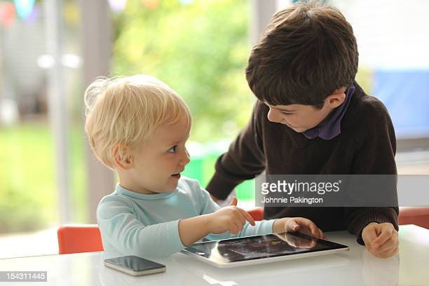 Boys playing on tablet computer