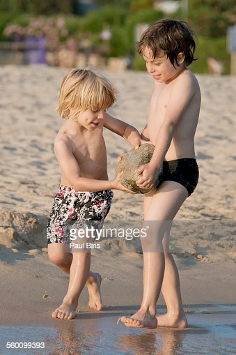 Boys playing on the beach, Plage d'Arone, Corsica - stock photo