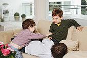 Boys playing on the sofa