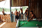 Boys playing pool in a village bar in a clearing in the rainforest The Floresta Nacional do Tapajos a 6500 km2 protected reserve was home to several...