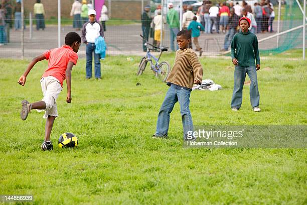Boys playing soccer in Township