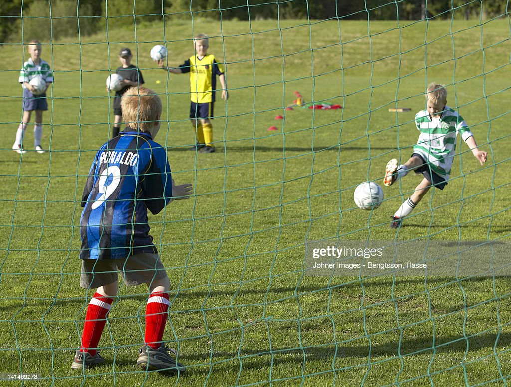 Boys playing soccer : Stock Photo