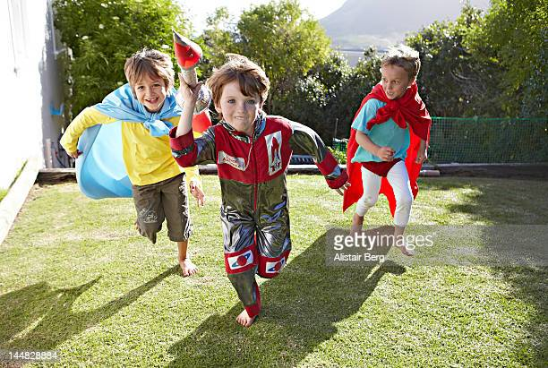 Boys playing together in a garden