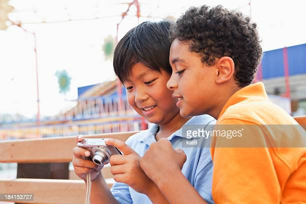 Boys playing with digital camera
