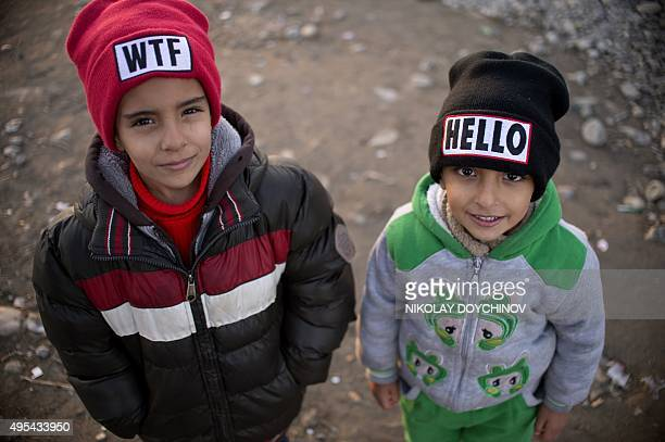 Boys pose after crossing the GreekMacedonian border near Gevgelija along with other migrants and refugees on November 3 2015 More than 218000...