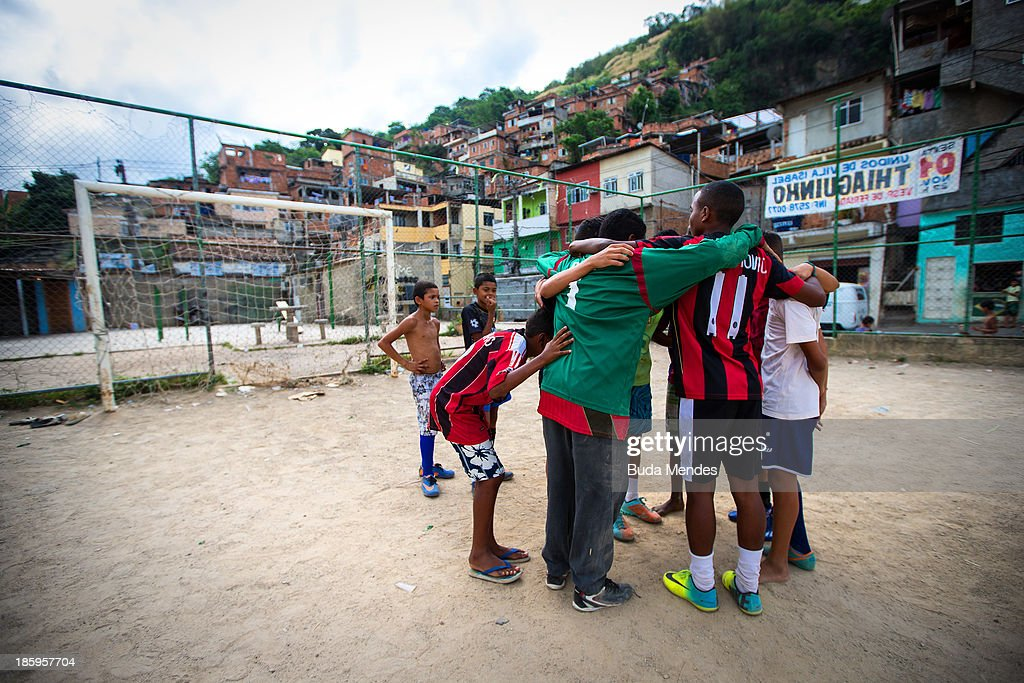 Boys prepare for training at the Vila Nova Project in the Morro dos Macacos area on October 26, 2013 in Rio de Janeiro, Brazil. The Project Vila Nova was idealized by Alex Sandro and has so far run for 2 years, catering to children and young residents of the Morro dos Macacos area.