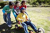 Boys pushing a go cart