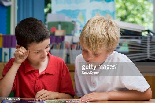 Boys reading a comic in school
