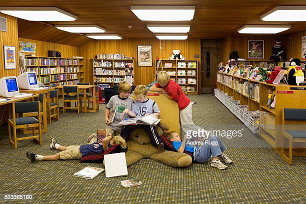 Boys Reading in Library of Blake School
