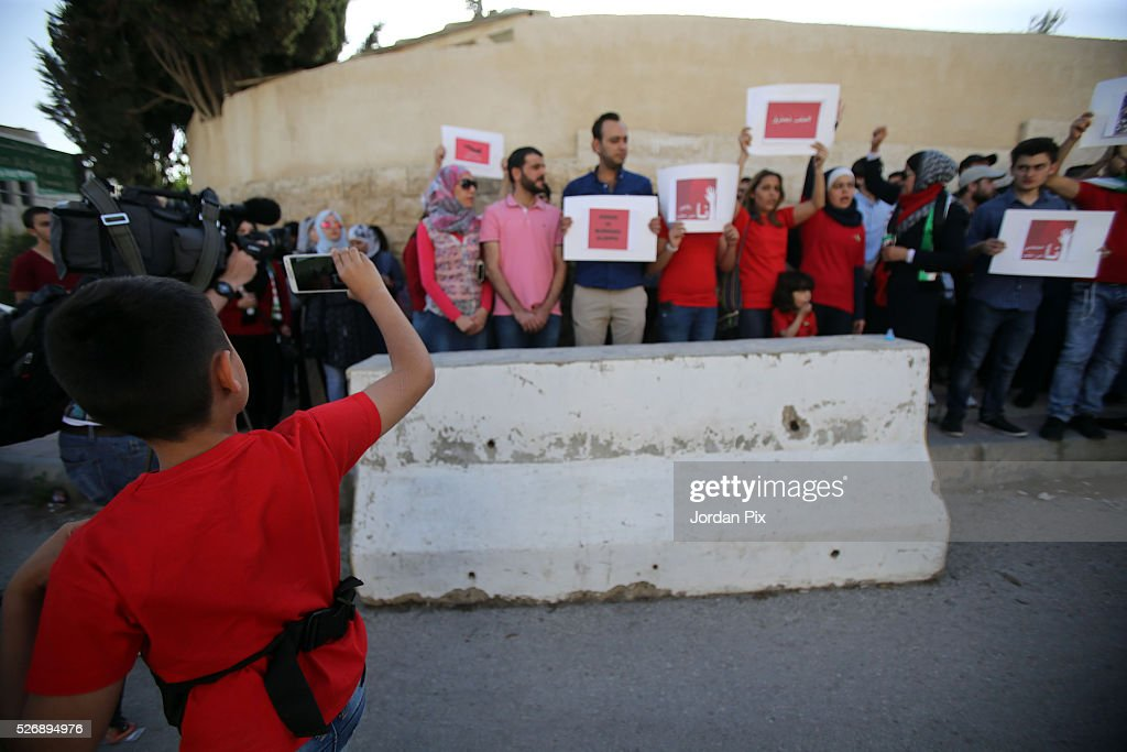 A boys records a video on his phone as Syrian refugees living in Jordan protest against the world silence towards the air strikes over the northern Syrian city Aleppo during a sit-in protest in front of the UN Headquarters on May 1, 2016 in Amman, Jordan. According to news reports, many civilians have been killed as a result of airstrikes.