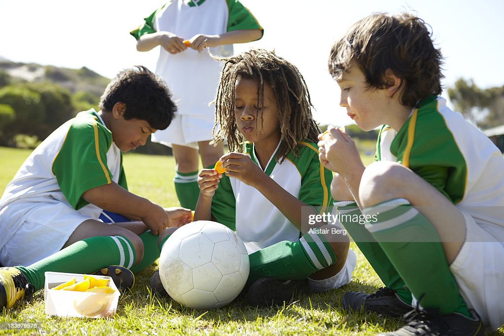 Boys resting during half time of a football match