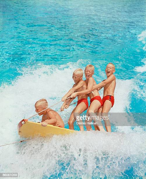 Boys riding on a water sled