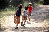 boys running on trail