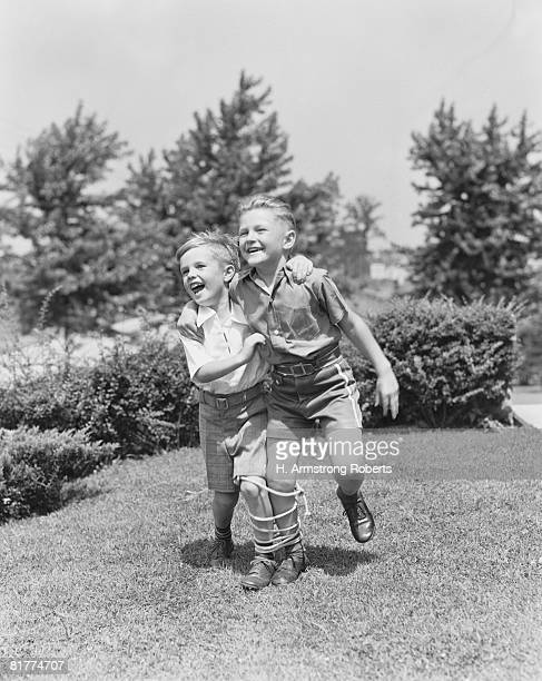 Boys running three-legged race.