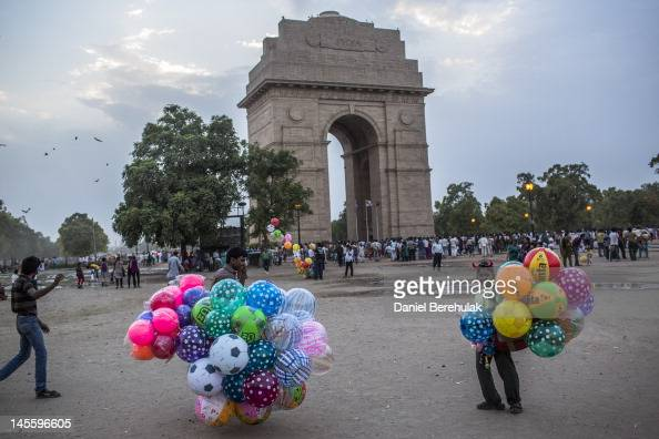 Boys selling balloons wait for customers at the India Gate monument on June 2 2012 in New Delhi India A Heat wave continues across the Northern India...