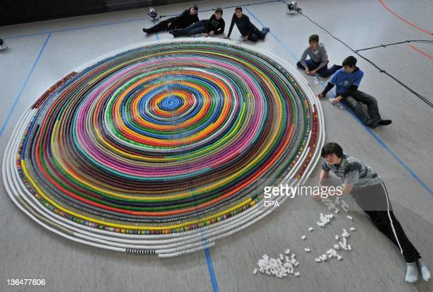 Boys set up a spiral of domino dices on January 6 2012 in Kefenrod central Germany 15yearold Patrick Sinner and his friends Julian JanEric Lukas...