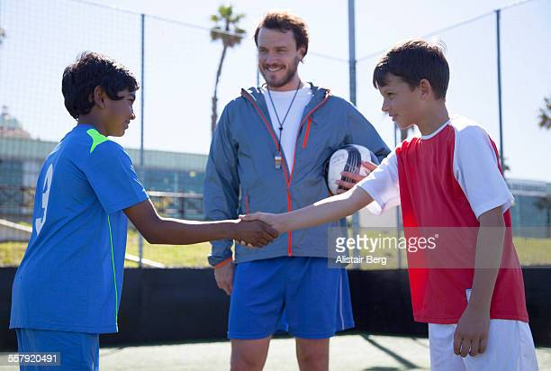 Boys shaking hands before soccer match
