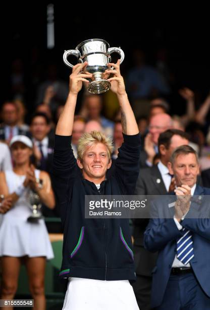 Boys' Singles final winner Alejandro Davidovich Fokina of Spain celebrates with his trophy on centre court on day thirteen of the Wimbledon Lawn...