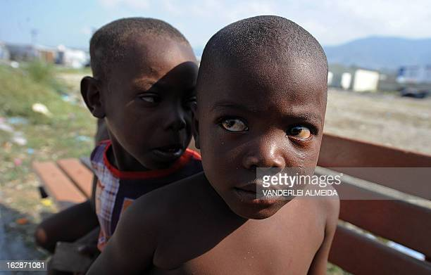 Boys sit on a bench at a camp of survivors of the January 2010 quake in Haiti which killed 250000 people on February 28 2013 in PortauPrince The UN...