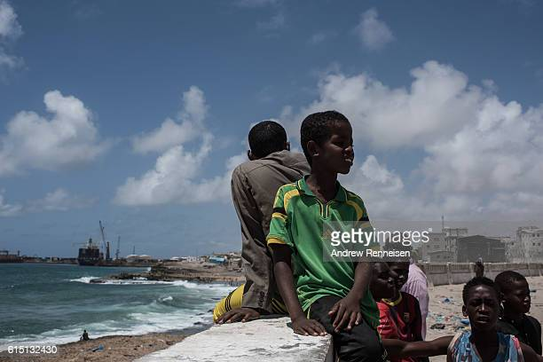 Boys sit outside a fish market on October 13 2016 in Mogadishu Somalia Somalia is on the brink of its first parliamentary elections since 1984 but...