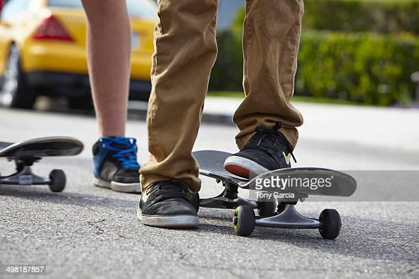 Boys skateboarding, close up
