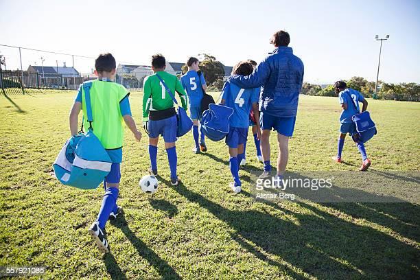 Boys soccer team arriving for a game