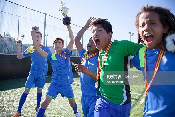 Boys soccer team celebrate winning