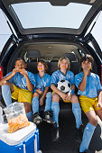 Boys' soccer team in car
