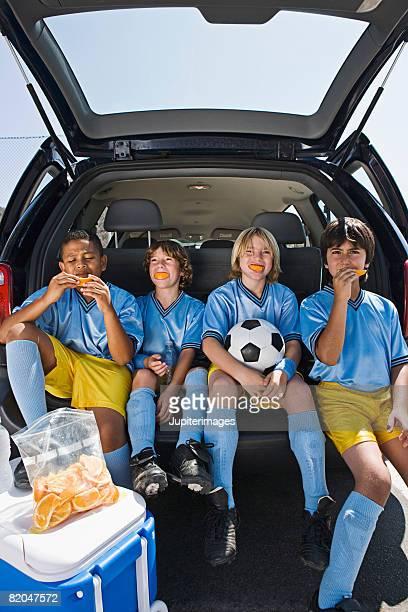 Boys' soccer team in car