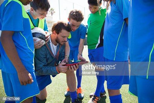 Boys soccer team preparing for a game : Stock Photo