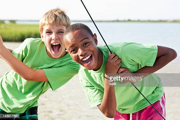 Boys standing on catamaran