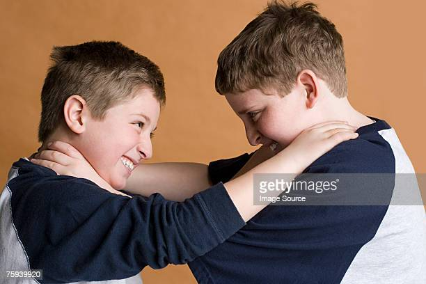 Boys strangling eachother