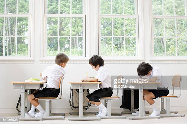 Boys studying in classroom
