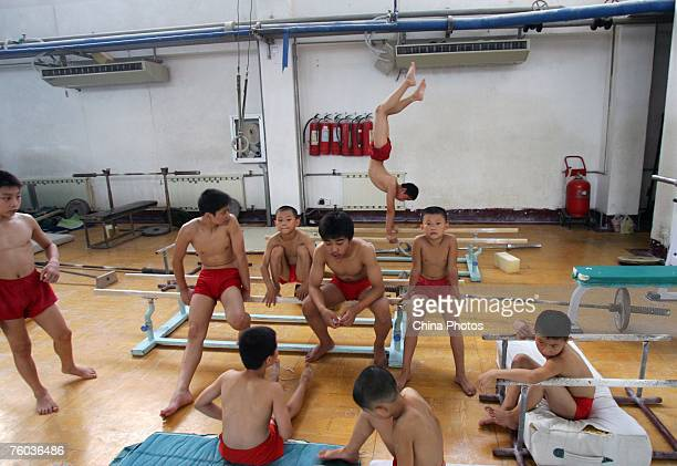 Boys take a break from their daily training at the Hubei Provincial Gymnastic Center on August 9 2007 in Wuhan of Hubei Province central China About...