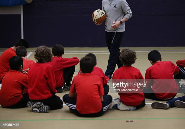 Boys take part in a basketball lesson in the sports hall at a secondary school on December 1 2014 in London England Education funding is expected to...
