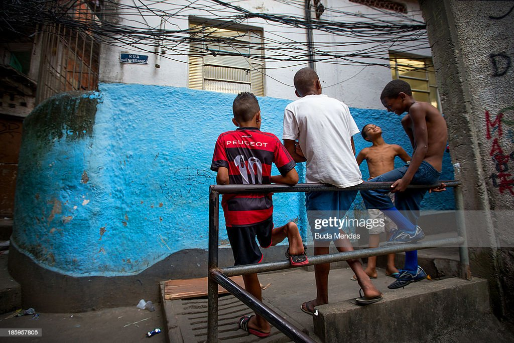 Boys talk near the Vila Nova Project in the Morro dos Macacos area on October 26, 2013 in Rio de Janeiro, Brazil. The Project Vila Nova was idealized by Alex Sandro and has so far run for 2 years, catering to children and young residents of the Morro dos Macacos area.
