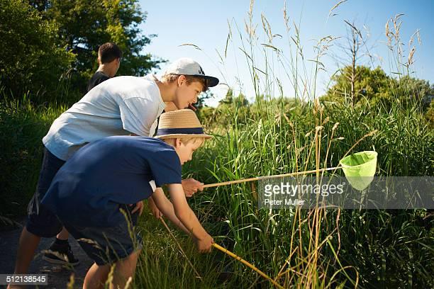 Boys using fishing nets